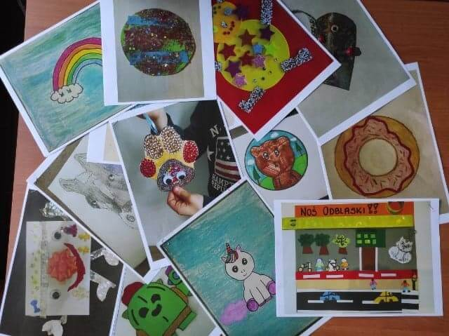 Kolorowe prace plastyczne dzieci przedstawiające projekty odblasków.